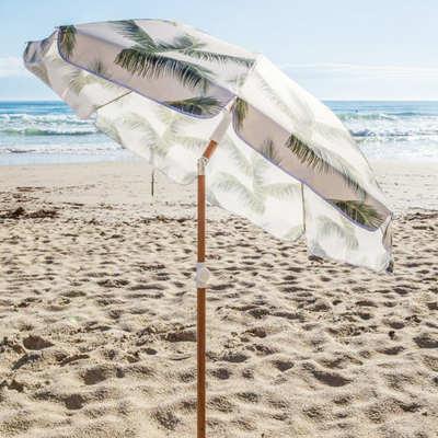 retro palm tree beach umbrella with wood pole